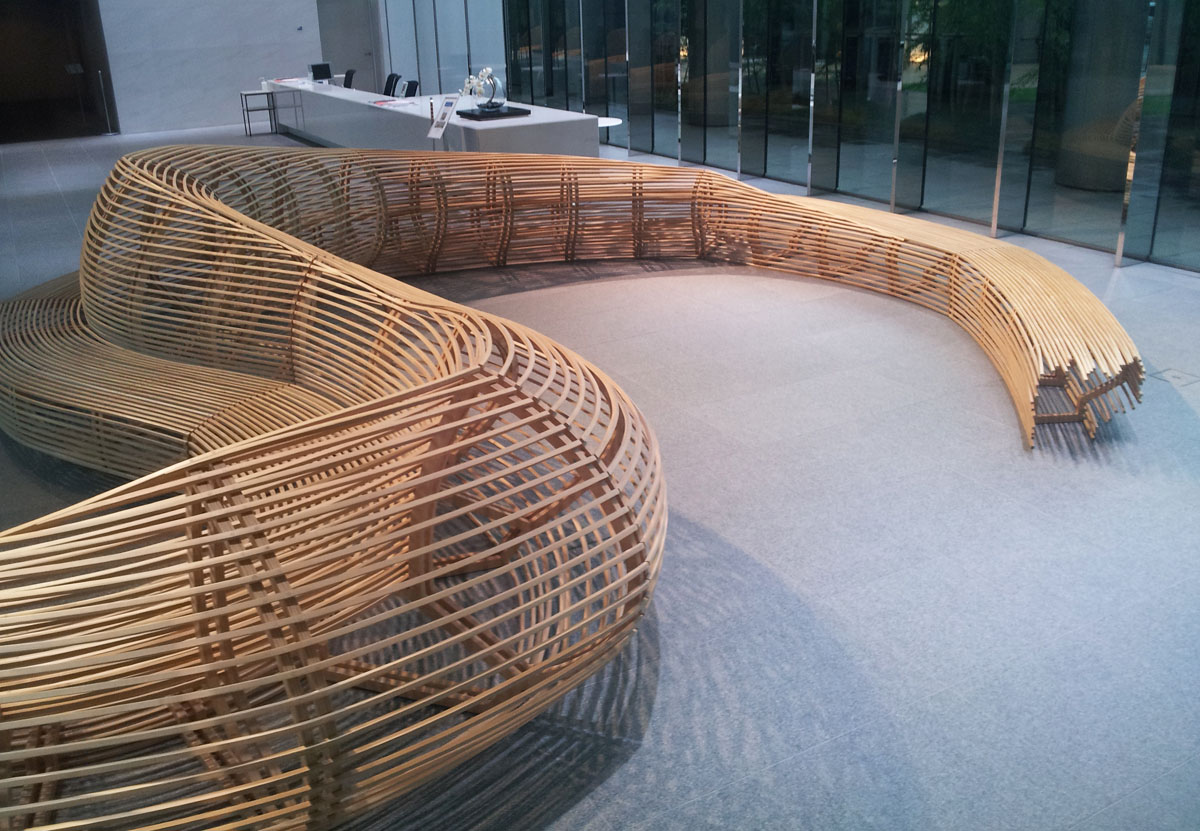 A huge bamboo dragon curls around to make a seating area in the lobby of the TK Minami Aoyama Bldg., June 24, 2014